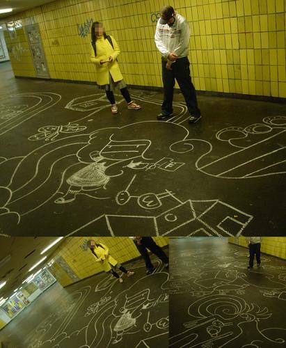 Dibujo con tiza en el suelo y un chico y una chica